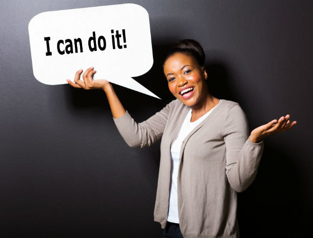woman holding I can do it speech bubble 698 x 465